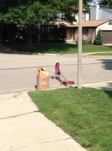 """Helping"" me sweep out the garage.  Aka, stealing the good broom and sweeping our street."